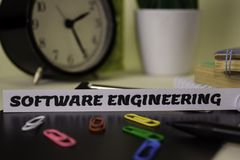 Software Engineering on the paper isolated on it desk. Business and inspiration concept stock photography