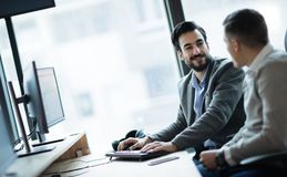 Software engineers working in office on project together royalty free stock photo