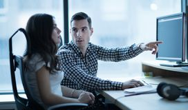 Software engineers working in office on project together royalty free stock photography