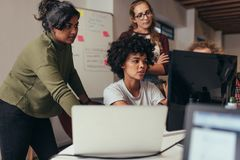 Free Software Engineers Working On Project Together Stock Image - 129558611