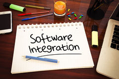 Software Integration. Handwritten text in a notebook on a desk - 3d render illustration Royalty Free Stock Photography
