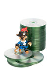 Software piracy. Toy pirate and cd disks concept of software piracy color image isolated on a white background Royalty Free Stock Image