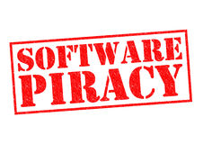 SOFTWARE PIRACY. Red Rubber Stamp over a white background Stock Photos