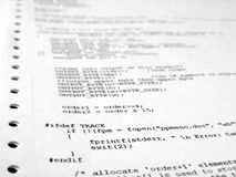Software program. A sheet of paper with several lines of software program code in C language royalty free stock images