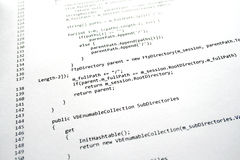 Software program code. A sheet of paper with several lines of software program code in C# language stock photo
