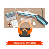 Software programmer typing code or debugging. Sitting at the desk, working on multiple displays. Top view flat vector illustration Royalty Free Stock Photos