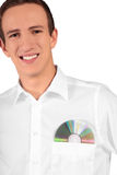 Software specialist. A young software specialist carrying a cd or dvd in his shirt pocket. All on white background Stock Image