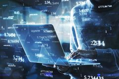 Software and technology concept. Side view of hacker using laptop with abstract big data interface on blurry background. Software and technology concept stock photography
