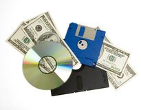 Software Upgrades cost. From really old floppy discs to newer diskettes to CD, with 100 dollar bills layered in between. Represents high upgrade costs (isolated Stock Images