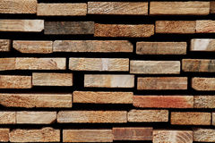 Softwood Texture: Detail of Sawn Wooden Slats. Detail of a timber stack`s sawed cutting edges, belonging to different kinds of softwood royalty free stock photography