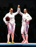 Sofya Velikaya L and Yana Egorian of Russia after final in the Women`s individual sabre of the Rio 2016 Olympic Games Royalty Free Stock Image