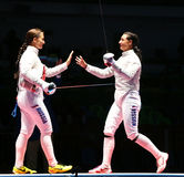 Sofya Velikaya L and Yana Egorian of Russia after final in the Women`s individual sabre of the Rio 2016 Olympic Games Stock Image