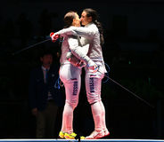 Sofya Velikaya L and Yana Egorian of Russia after final in the Women`s individual sabre of the Rio 2016 Olympic Games Stock Photos