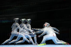 Sofya Velikaya of Russia L and Mariel Zagunis of United States compete in the Women`s Sabre Team of the Rio 2016 Olympic Games Stock Image