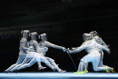 Sofya Velikaya of Russia L and Mariel Zagunis of United States compete in the Women`s Sabre Team of the Rio 2016 Olympic Games Stock Images