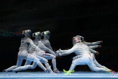 Sofya Velikaya of Russia L and Mariel Zagunis of United States compete in the Women`s Sabre Team of the Rio 2016 Olympic Games Royalty Free Stock Photos