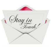 Soggiorno in comunicazione della lettera di tocco che tiene aggiornata Fotografia Stock Libera da Diritti