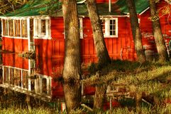 Soggy Cabin. Cabin in Waterton Park stood in water, went for colours and reflections Stock Photo