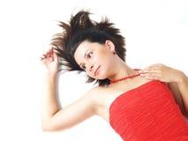 Sognando in vestito rosso Immagini Stock