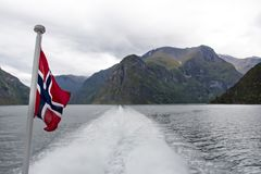 Sognefjord landscape in western Norway with flag and ferry wake stock photography