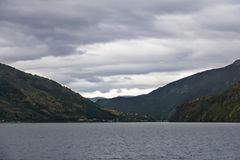 Sognefjord landscape in western Norway with a village in the dis royalty free stock images