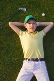 Sogni del giocatore di golf del ragazzo Fotografie Stock