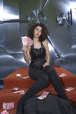 Sogno criminale femminile sopra il suo bottino Fotografia Stock