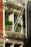 Soho building facade close-up with fire escape, New York City Stock Photo