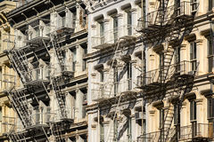 Soho building facades and fire escapes, New York City. Soho building facades with fire escapes. Manhattan, New York City Royalty Free Stock Images
