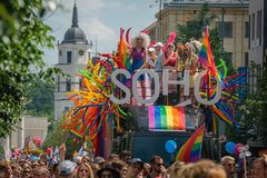 SOHO bus with drag queens at Baltic Pride event, men dressed as woman on gay parade stock photography