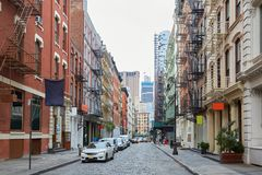 Soho empty street with cast iron buildings in New York. NEW YORK - SEPTEMBER 7: Soho empty street with cast iron buildings on September 7, 2016 in New York. The stock images