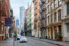 Soho empty street with cast iron buildings in New York. NEW YORK - SEPTEMBER 7: Soho empty street with cast iron buildings on September 7, 2016 in New York. The Royalty Free Stock Photo