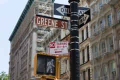 Soho Greene St sign Manhattan New York City. Soho Greene St sign in redlight Manhattan New York City NYC USA Stock Photo
