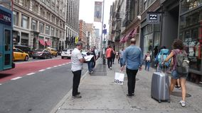 Soho in New York City. Pedestrians and traffic in Soho, New York City stock video