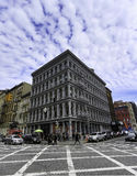 New York City Streets -Soho. Soho New York City Streets against a blue sky and puffy clouds Royalty Free Stock Image