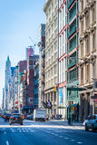 SOHO shopping district in New York City. South of Houston St. in New York City on a weekday morning.  The famous area, known as SOHO, is known for its shopping Stock Photography
