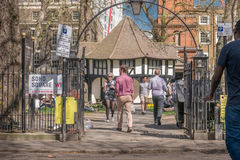 Soho Square. An entrance to Soho Square, London, a popluar lunchtime venue for workers in the area Royalty Free Stock Images
