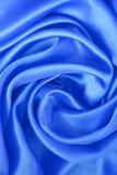 Soie bleue élégante lisse comme fond Images stock