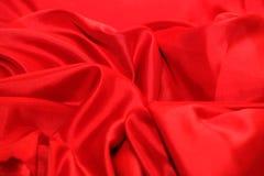 Soie rouge élégante lisse images libres de droits