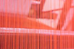 Soie rouge dans la machine Images libres de droits