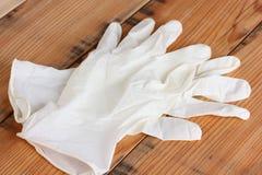 Soigne des gants photographie stock libre de droits