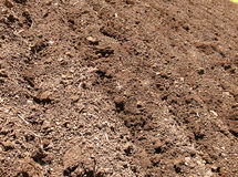 Soil Background. Background of plowed soil in the field Stock Photography