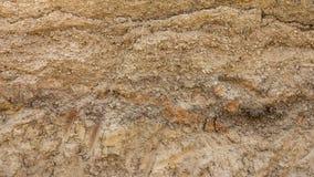 Soil below the gravel road. Royalty Free Stock Image