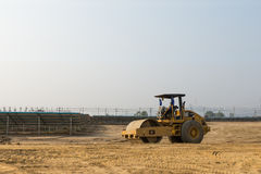 Soil compactor in the under construction solar farm Royalty Free Stock Photo