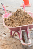 Soil in construction trolley at construction site Royalty Free Stock Image