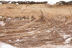 Soil cut-sandstone, stones, sand. structure layers. Soil cut-sandstone, stones, sand structure and layers Royalty Free Stock Image