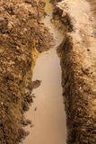Soil dug to allow water Stock Image