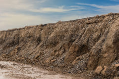 Soil eroded under dirt road. Royalty Free Stock Images