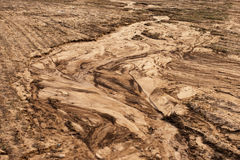 Soil erosion. The texture of sandy soil, which was destroyed by meltwater Stock Images