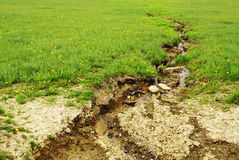 Soil erosion field. Soil erosion, destroy of field by water, environmental concept stock image